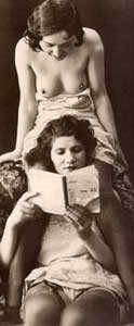 Vintage Erotica Picture of Two Topless Women Reading a Sex Story