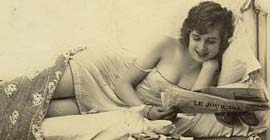 Erotic Girl reading the newspaper in bed