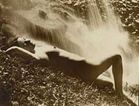 Nude Woman lying by a waterfall: Sex in the great outdoors