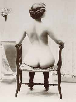 Picture of Naked Lady sitting on stool showing off her hot sexy ass